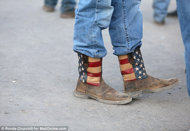 A Cliven Bundy supporter wears patriotic cowboy boots at the rally