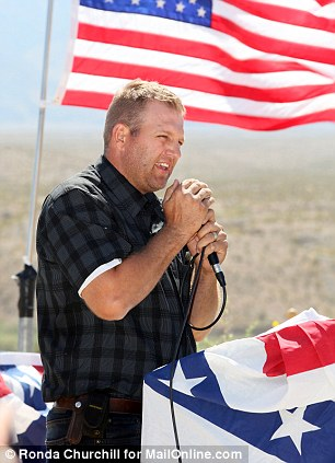 Ammon Bundy, Cliven Bundy's son, speaks during a prayer ceremony at a supporter camp located near the Virgin River Sunday