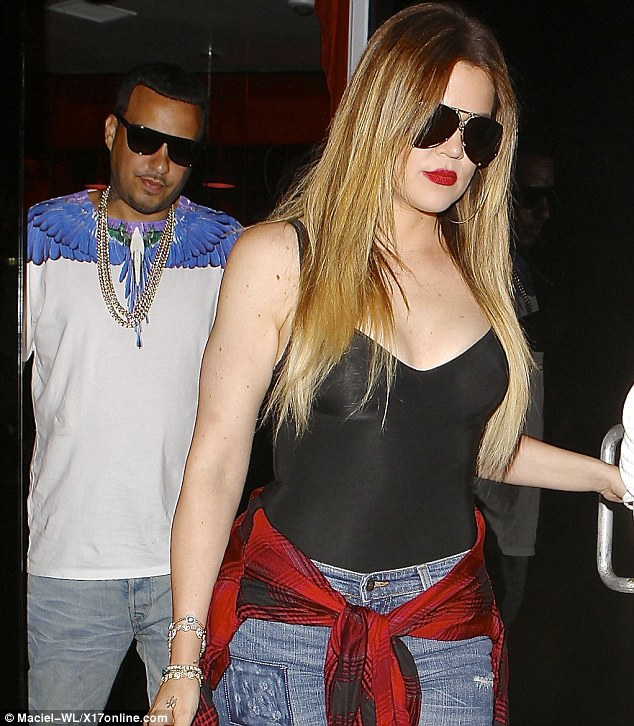 One lucky man! Khloe Kardashian looked extremely sexy in a low-cut bodytop and jeans as she left Philippe Chow in Beverly Hills with French Montana on Sunday