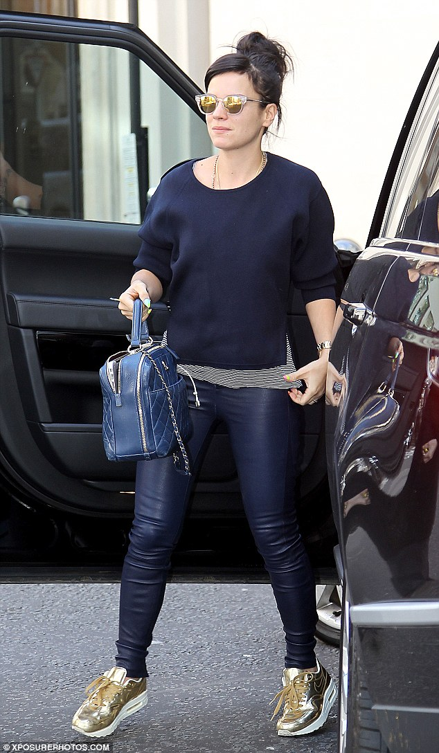 Ready to work: The Hard Out Here songstress was seen in the rathter toned-down ensemble as she arrived at the BBC studios
