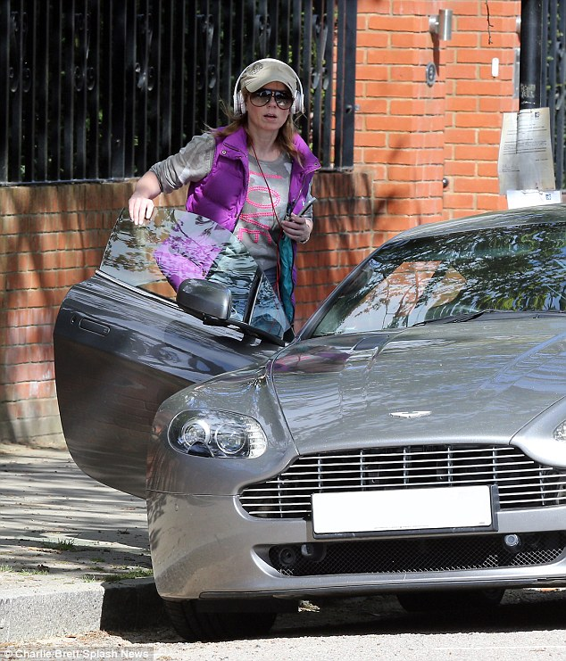 Geri Halliwell steps out near her North London home in her new Aston Martin sports car
