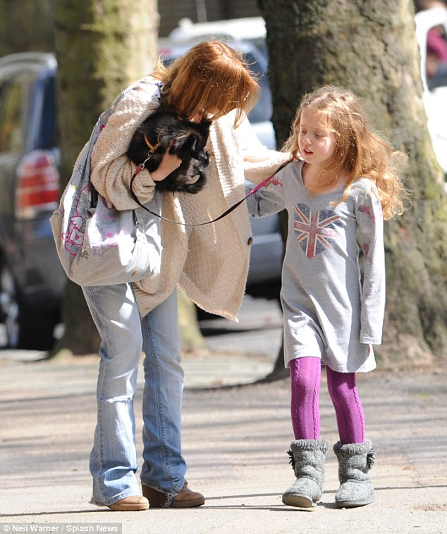 Fitting tribute: Geri Halliwell was seen walking in north London with her daughter, Bluebell, on Monday - whom she had dressed in a union Jack dress