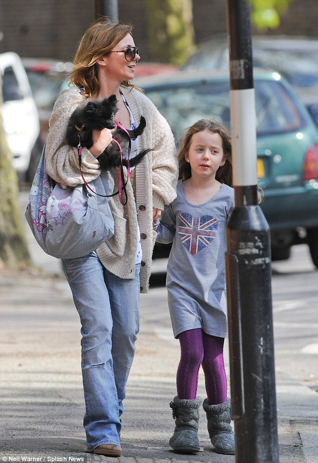 Like father, like daughter: Geri Halliwell and daughter Bluebell - who looks just like her father - enjoy a day out in London