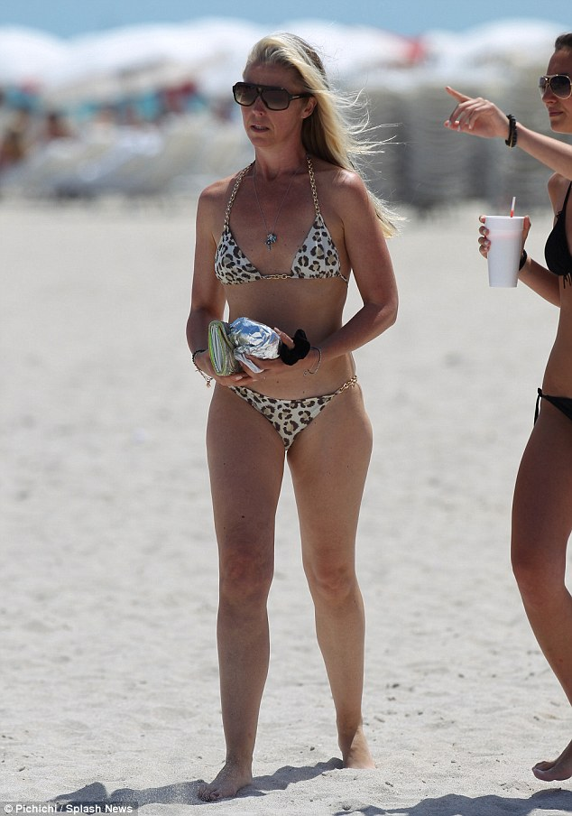 Phwoarty-four: Tamara Beckwith looked stunning as she picked up a burger from a fast-food truck on a Miami beach on Monday