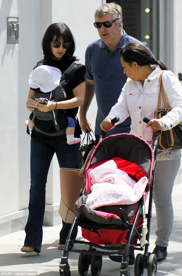 One happy family: Hilaria is frequently seen with her husband Alec Baldwin, right, and daughter Carmen and even enjoyed Sunday with them in Calabasas