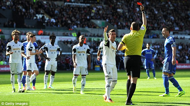 Seeing red: Flores (third right) is dismissed following the intervention of Terry (right)