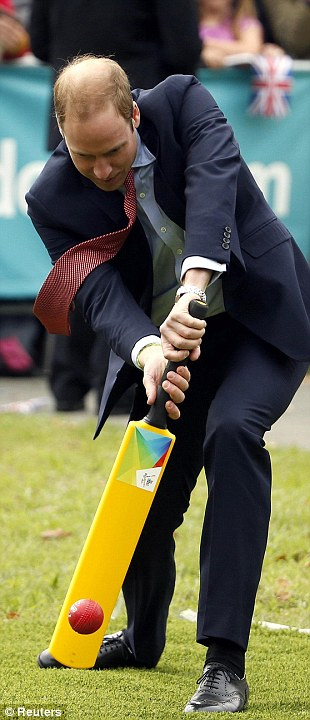 Having a ball: Prince William, a keen player in his youth, struck several balls bowled to him by local schoolchildren fairly impressively