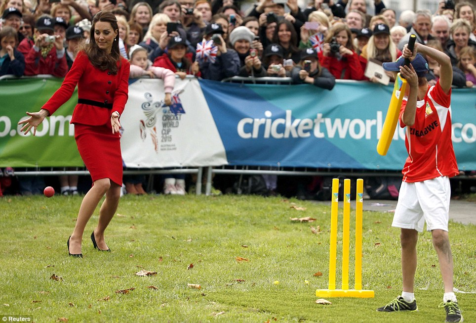 Catch it Kate! The young Royals played the game of cricket with some local children