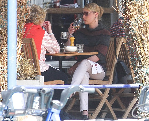 Enjoying a glass of wine: The actress opted for white while her mum chose red as they chatted