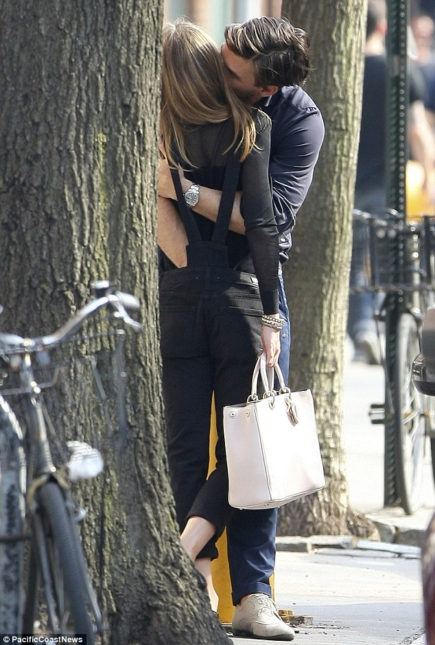 Ooh la la! The 28-year-old even plunged his hand down the waist of Olivia's overalls as he went in for a better feel while tenderly kissing her neck - not that the fashionista was complaining, clearly enjoying the moment as she lifted her leg up in response