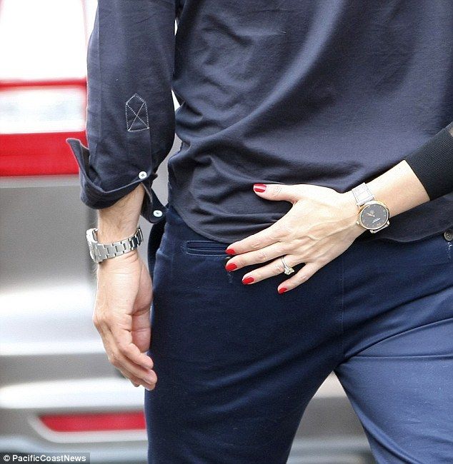 That's one way to show off your bling! The 28-year-old former The City star flashed her impressive engagement ring as she rested her red-manicured hand tenderly on Johannes' bottom as they walked along