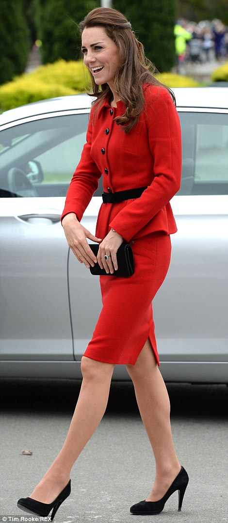 The Duchess looked stunning for her day of engagements in a red two-piece suit