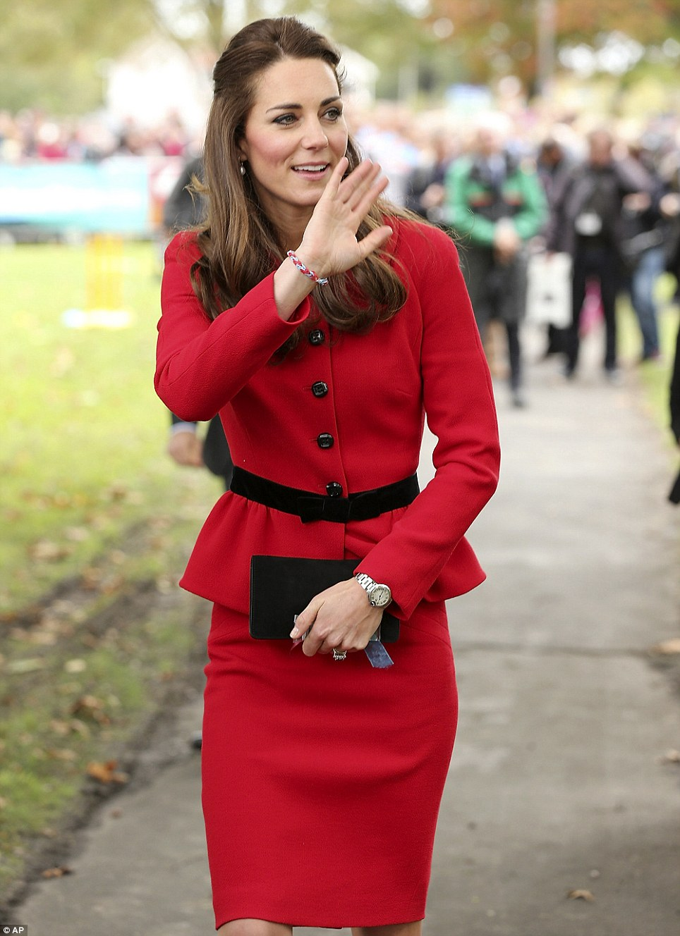 The down-to-earth Duchess wore a colourful loom bracelet that was given to her during the day