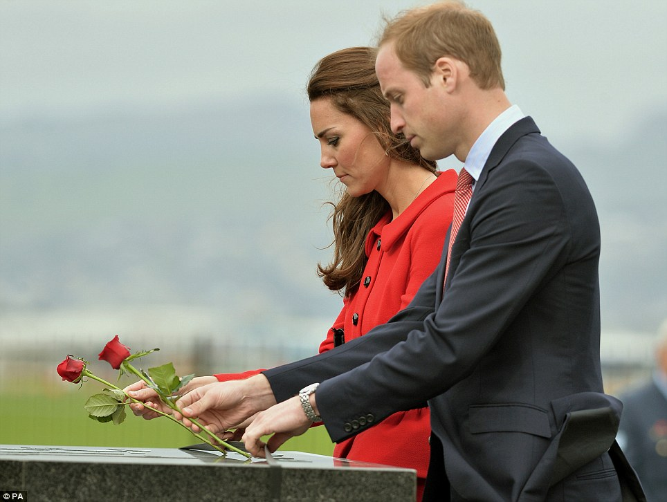 The Duke and Duchess of Cambridge laid roses as they viewed the RNZAF Memorial Wall at the Wigram Air Force Base museum in Christchurch, during the eighth day of their official tour to New Zealand on Monday