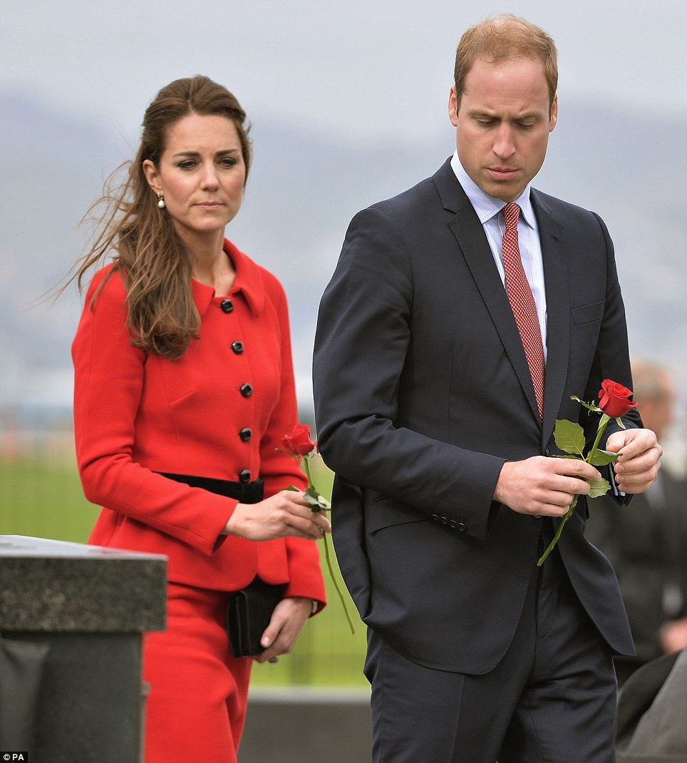 Both Prince William and Kate looked sombre as they each laid a single red rose on a plague at the wall