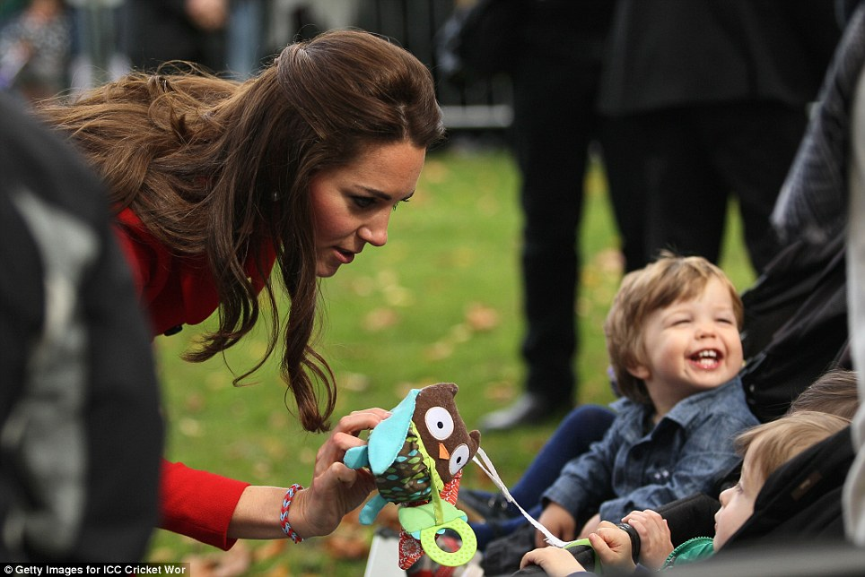 Mother-of-one Kate was a natural with the tiny tots she came to greet