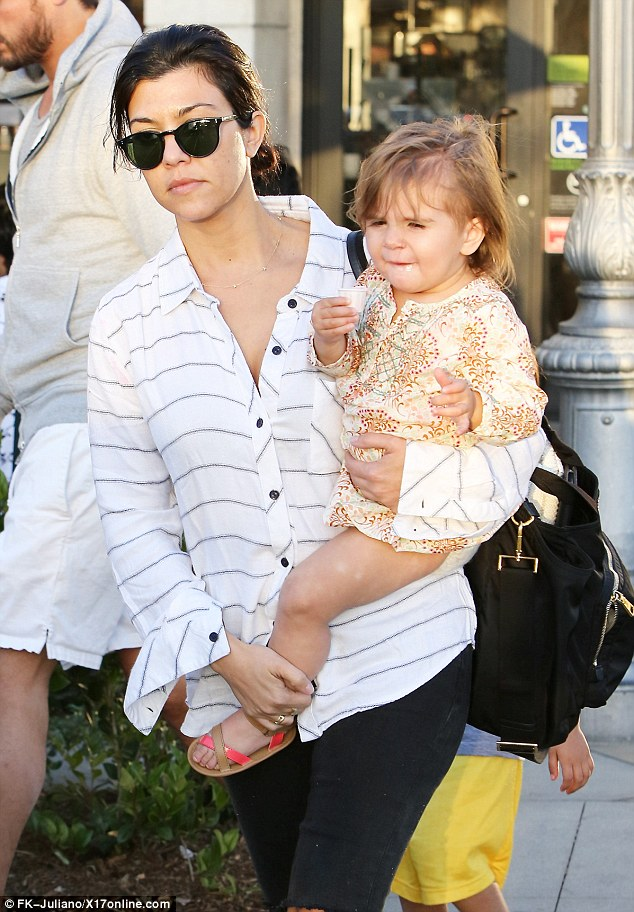 What a treat! The 21-month-old happily snacked on a tiny sample-size cup of dessert as Kourtney carried her to their car, looking fresh-faced and fabulous with not a lick of make-up on her face, her eyes shielded by dark sunglasses, her brunette locks worn in a messy bun