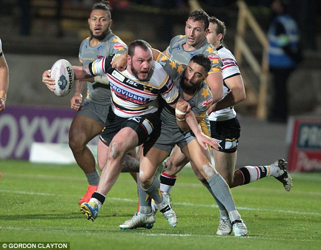 Thick of it: Dale Ferguson is halted by Salford's Rangi Chase during the match at Odsal