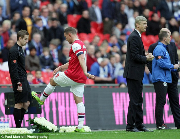 Angy: Lukas Podolski kicked a water bottle when he was brought off by Arsene Wenger