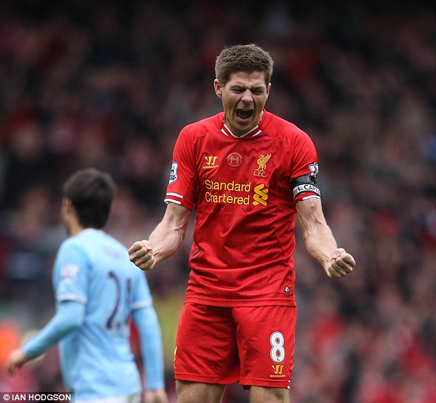 Overwhelmed: Steven Gerrard celebrated with pride and passion after Liverpool beat Manchester City 3-2 to move a step closer to their first title in 24 years