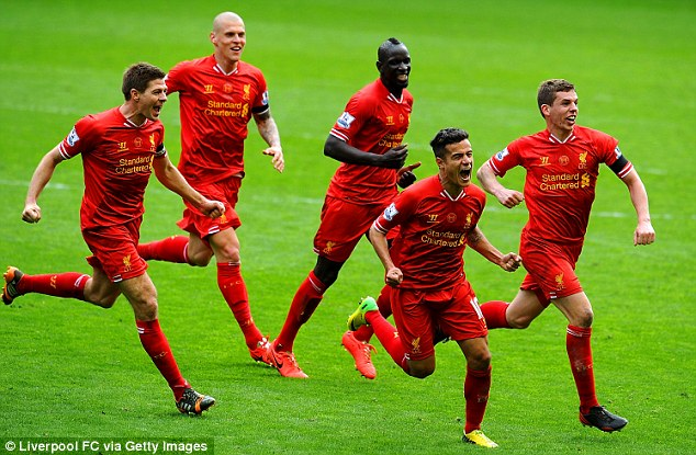 Crucial moment: Philippe Coutinho leads the celebrations after scoring the decisive goal at Anfield