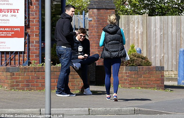 The wall does its job: Gerrard patiently sits and waits as Alex comes back from shopping