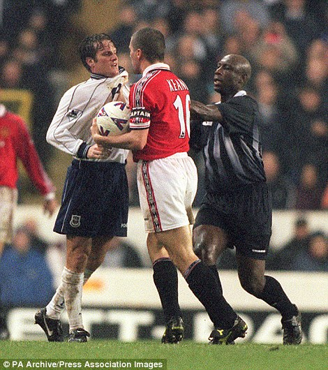 Referee Uriah Rennie moves in to separate Tottenham's Andy Sinton (left) and Manchester United captain Roy Keane, following Sinton's challenge on David Beckham, during a 1998 Premiership clash between Spurs and Manchester United at White Hart Lane