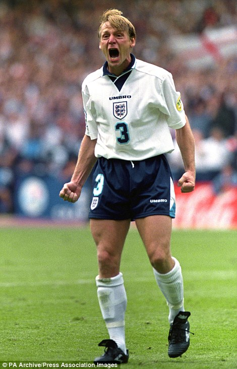 Stuart Pearce exorcises the ghosts of penalties past as he forcibly celebrates after scoring in the penalty shoot-out to decide the Euro 96 quarter final clash against Spain at Wembley