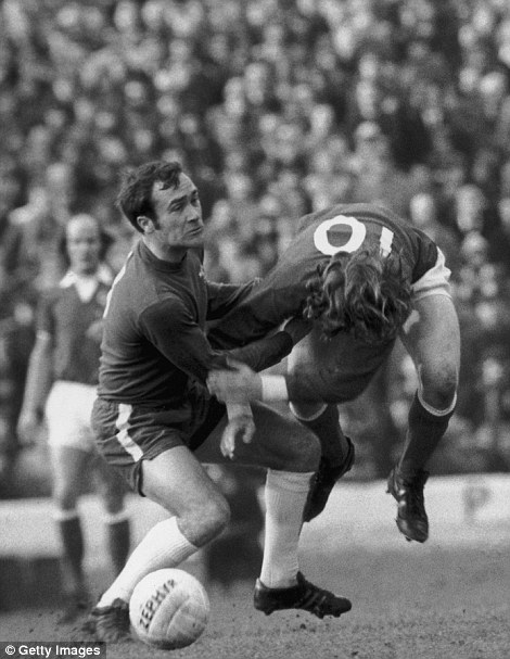 Chelsea defender Ron Harris (left) fouls Stan Bowles of Queens Park Rangers during a match at at Stamford Bridge, London, 23rd February 1974