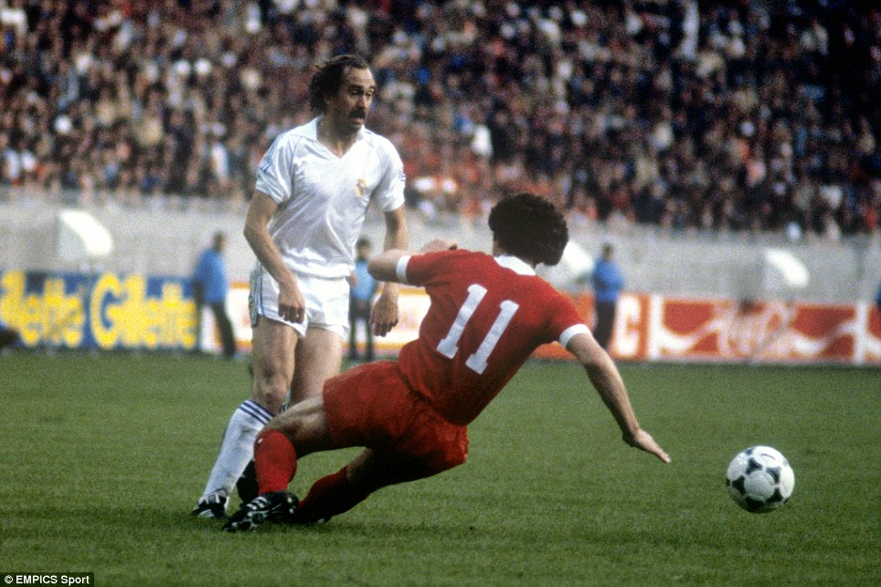 Liverpool's Graeme Souness slides in on Real Madrid's Uli Stielike despite the ball having already gone