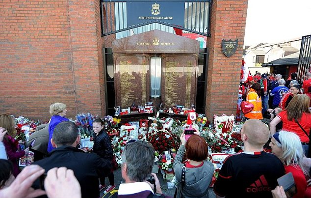 Gathering: Liverpool fans started arriving at the Hillsborough memorial at Anfield ahead of the service