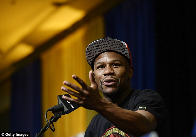 Ready to rumble: Floyd Mayweather announces his upcoming fight with Marcos Maidana