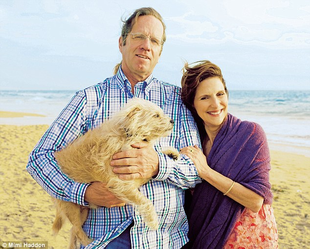 Elaine and husband Stephen on the beach at Santa Monica with their dog Puck