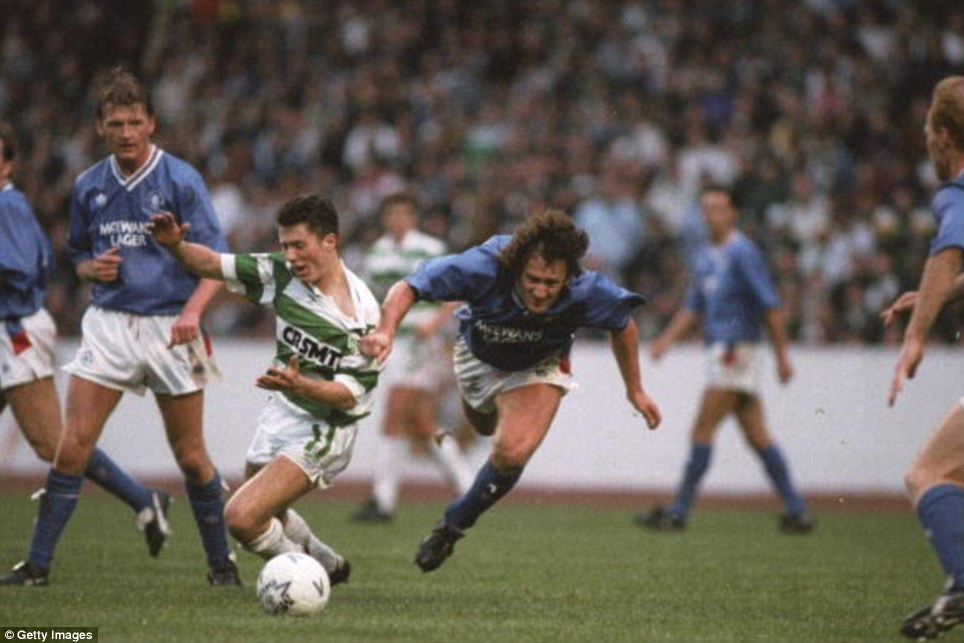 John Collins (centre) of Celtic is pulled down by Terry Hurlock (right) of Rangers during the Skol Cup Final at Hampden Park in Glasgow, Scotland. Rangers won the match 2-1