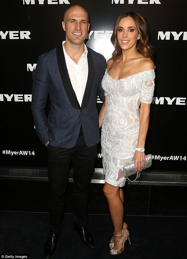 Proud parents: The Myer brand ambassador with husband Chris Judd at the store's Autumn Winter 2014 Fashion Launch in Melbourne in February
