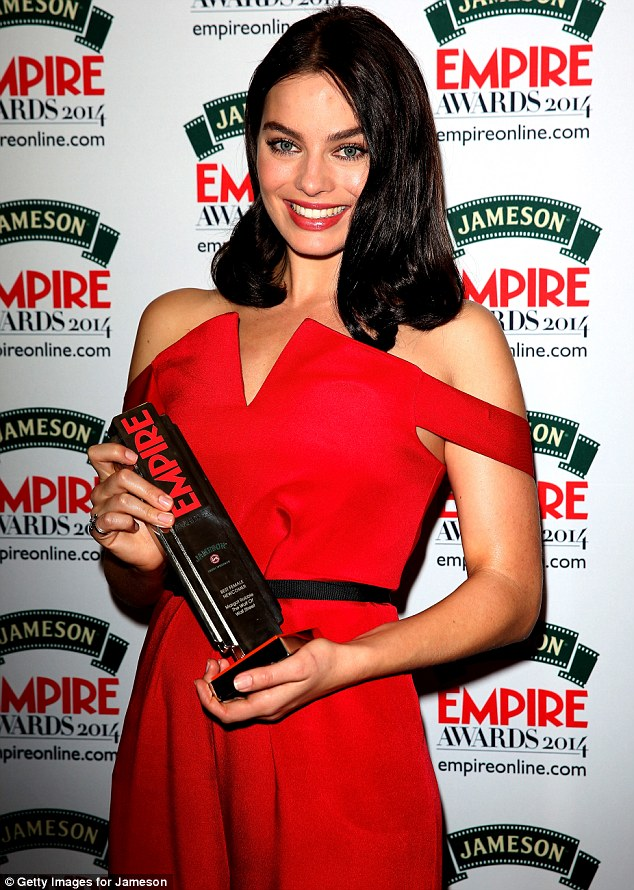 Brunette beauty! The 23-year-old pictured with her award for the Best Female Newcomer for The Wolf Of Wall Street at the Jameson Empire Awards in London last month