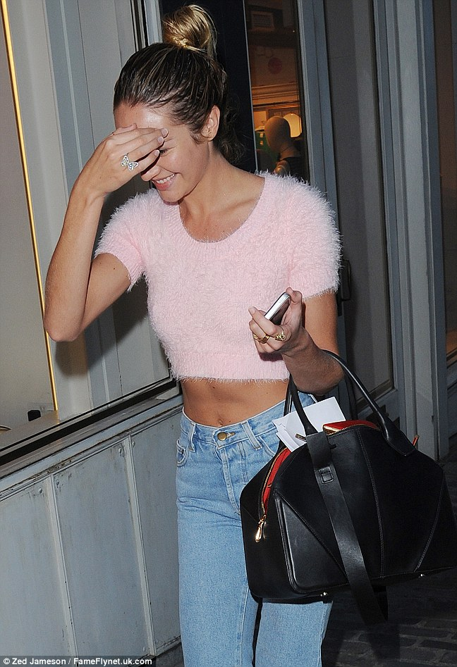 Sweet enough: Candice looked pretty in her marshmallow pink crop top on Bond Street