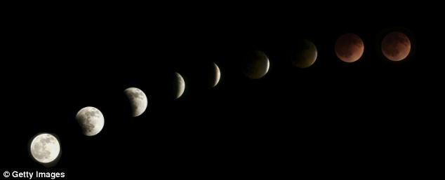 The moon is seen as it nears a total lunar eclipse in Venice, California. People across North ad South America were able to witness the first of four in a rare Tetrad of eclipses over the next two years