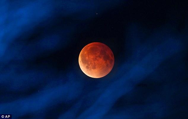 Illuminating: The moon glows orange, as seen from Milwaukee in the USA