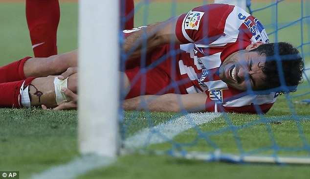 Brutal: Striker Costa cut his leg on the post during Atletico Madrid's win over Getafe