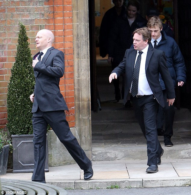 Here they come: The pair start to argue in the church before taking the fight outside