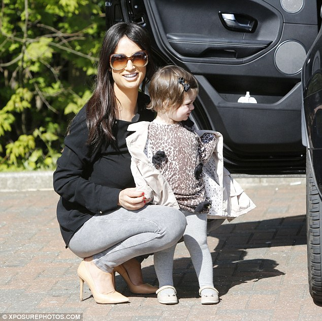 Like mother like daughter: Chantelle Houghton and her daughter run some errands together on Monday