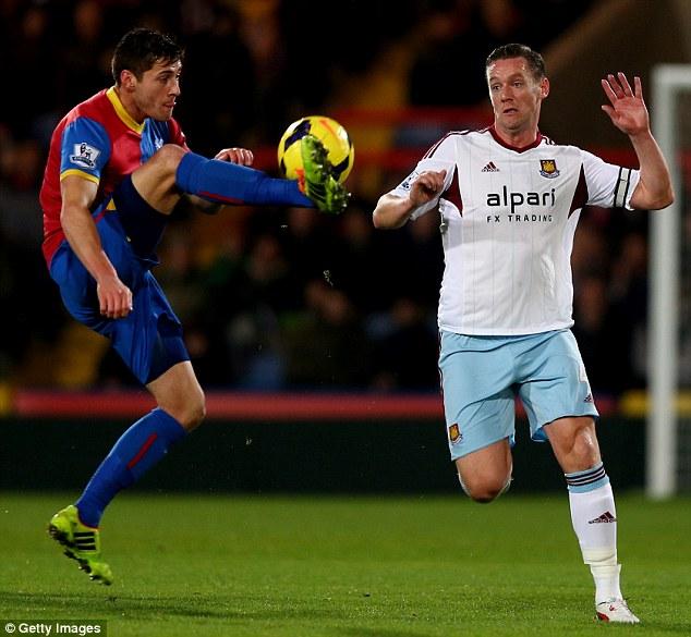 Captain marvel: West Ham skipper Kevin Nolan (right) battles with Joel Ward of Crystal Palace earlier this season