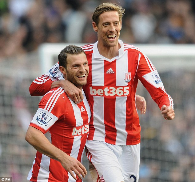 Peter the Great: Stoke City's Peter Crouch celebrates with Erik Pieters after scoring his team's second goal at Villa Park