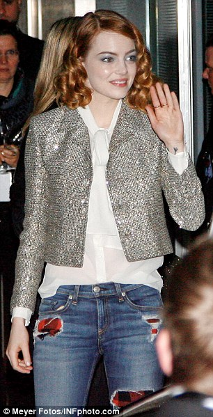 Looking good: Emma, 25, matched her silver cropped jacket with semi-sheer blouse and ripped jeans, while her ginger hair remained in the loose curled tresses she sported on the red carpet earlier that night