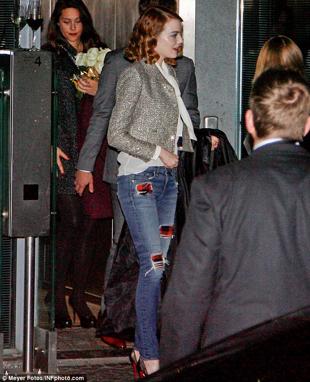 Here she comes: Emma Stone makes her way to Berlin's Soho House on Tuesday evening after attending The Amazing Spider-Man 2 premiere