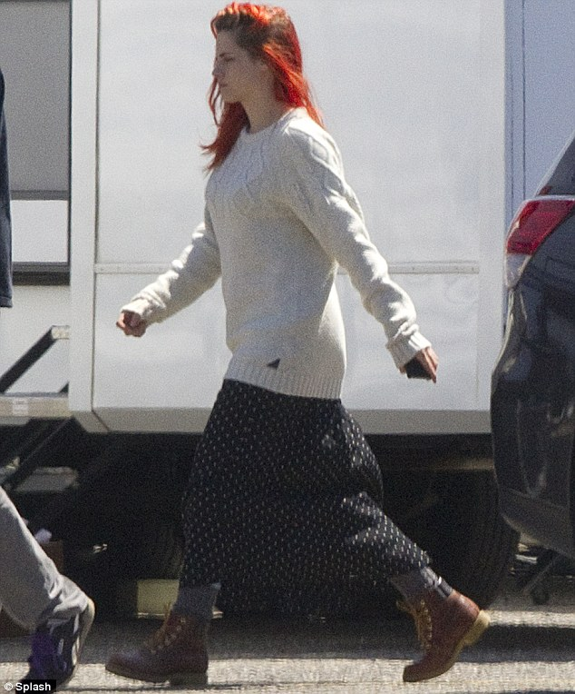 And off she goes: No doubt she had pressing matters to address on set as she marched away