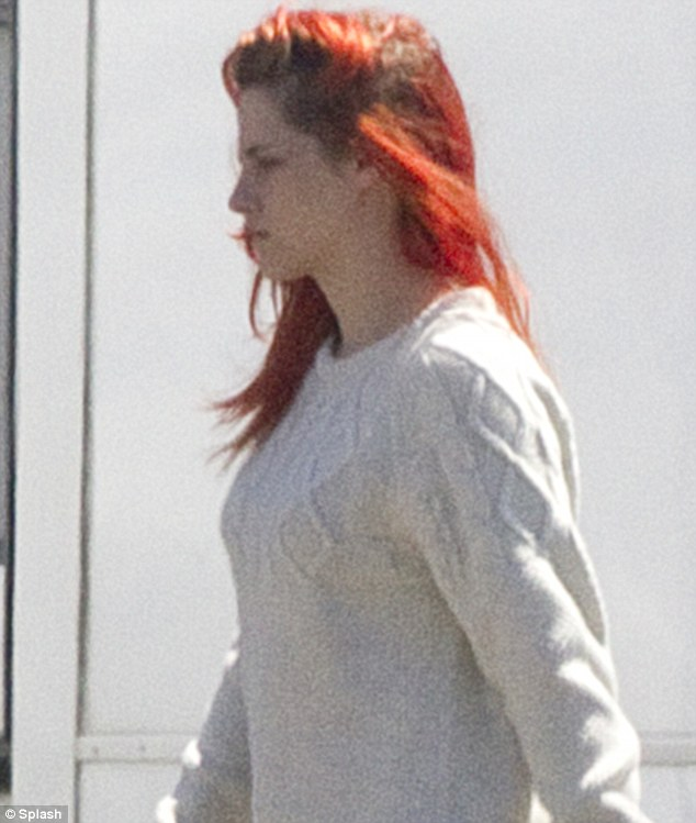 That's more like it: She was more like the Kristen her fans know and love when she pulled a sullen face