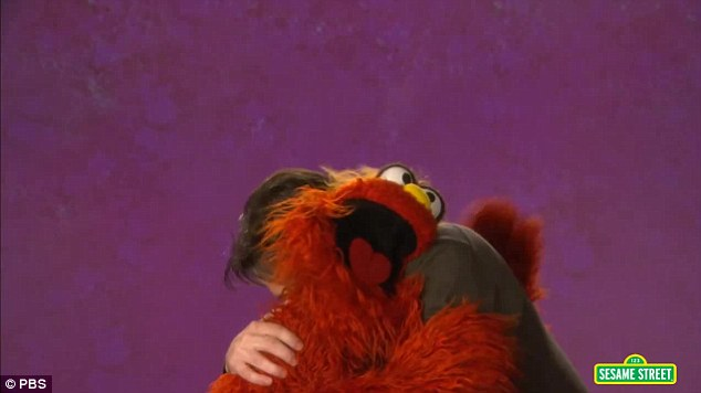 Awww... The duo then shared a big furry embrace