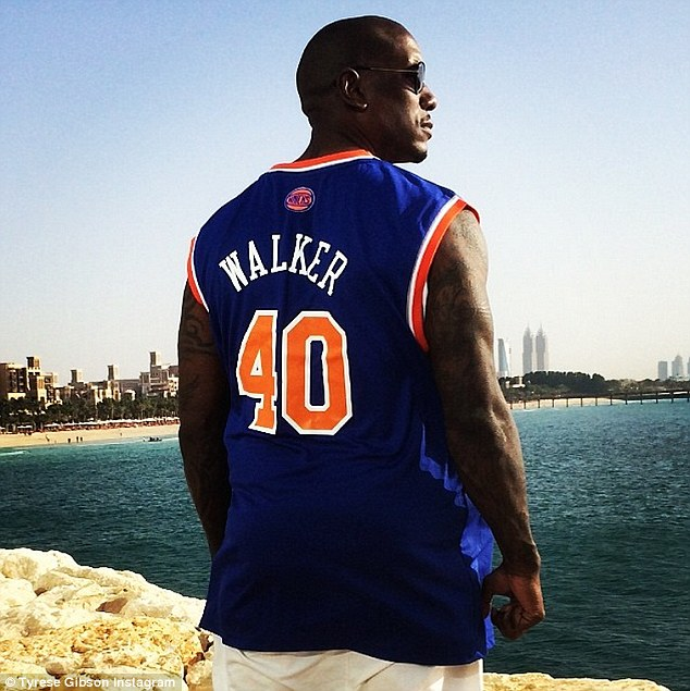 'I come here feel the energy of the ocean and all I think of is my brother..... Were gonna make you proud P-Dubber!!! (sic)' The 35-year-old paid tribute to his late best friend, donning a New York Knicks jersey emblazoned with 'Walker' and the number 40